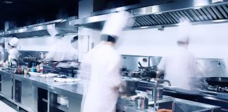Blurred image of chefs in a kitchen (Shutterstock)