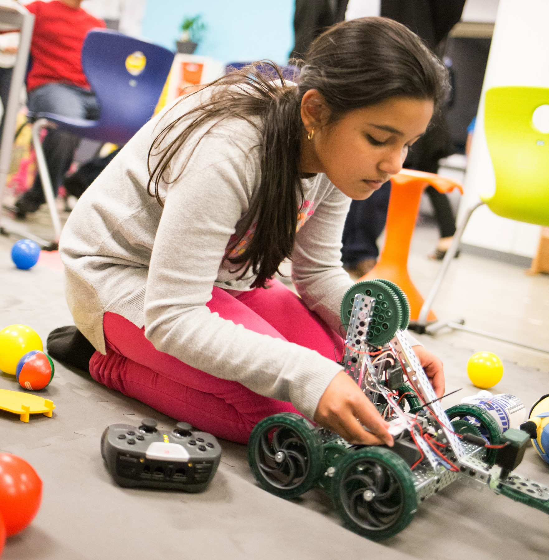 Student adjusting a remote-controlled car (Courtesy of Khan Academy)