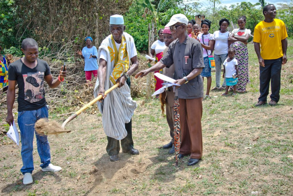 People breaking ground in field (Last Mile Health)