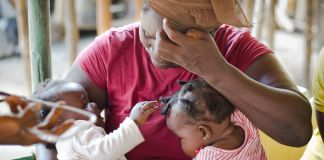 Woman holding twin children (Last Mile Health)