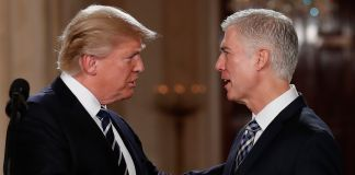 President Trump and Neil Gorsuch shaking hands (© AP Images)