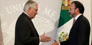 Rex Tillerson and Luis Videgaray Caso about to shake hands (© AP Images)