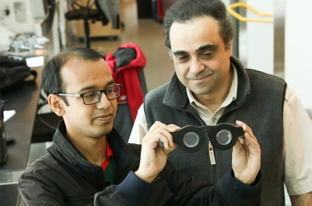 "Two people looking at ""smart glasses"" (Dan Hixson/University of Utah College of Engineering)"