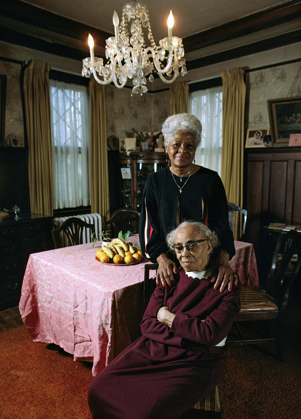 Two elderly women in dining room in home (© Karen Kasmauski/Corbis via Getty Images)