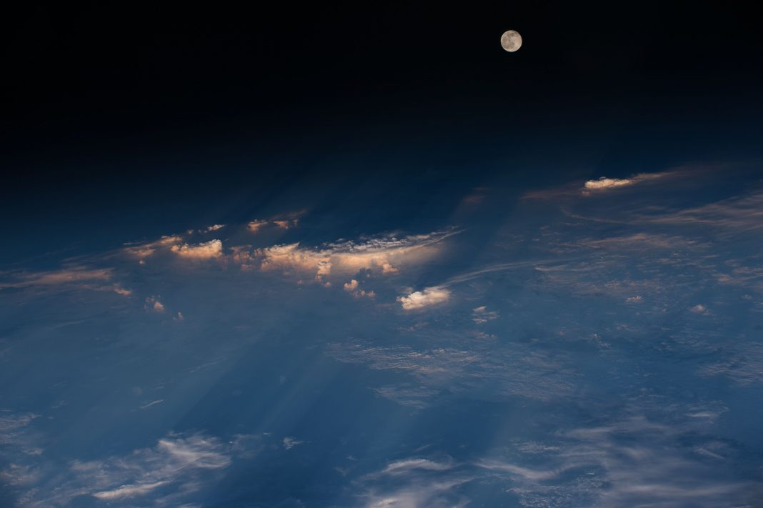 Earth seen from orbit with moon in distance (NASA)