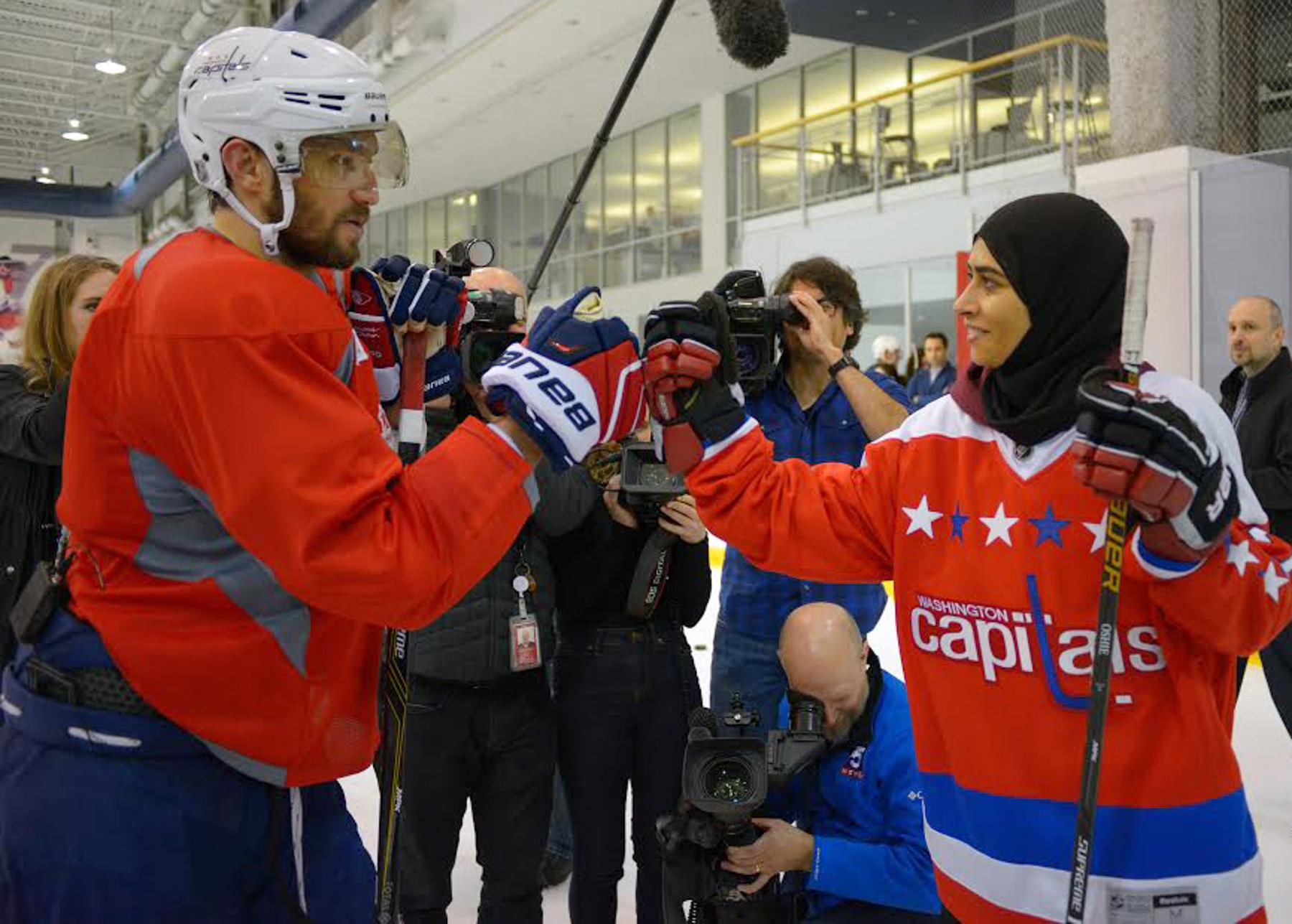 Hockey players bumping fists (© Washington Post via Getty Images)