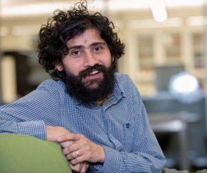 Manu Prakash seated (Linda A. Cicero/Stanford News Service)