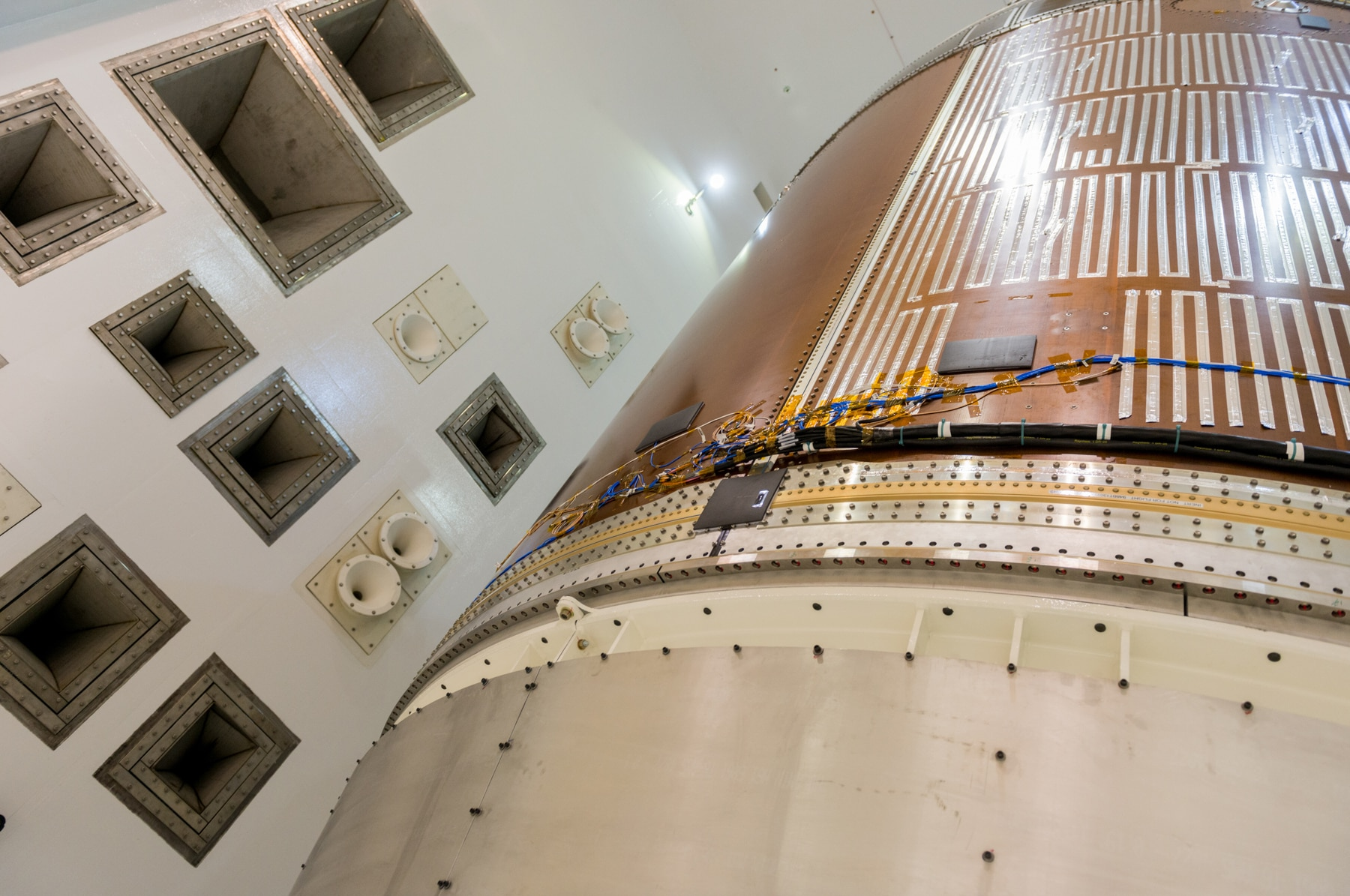 Close-up of space capsule in acoustic testing chamber (Alcyon Technical Services JV, LLC)