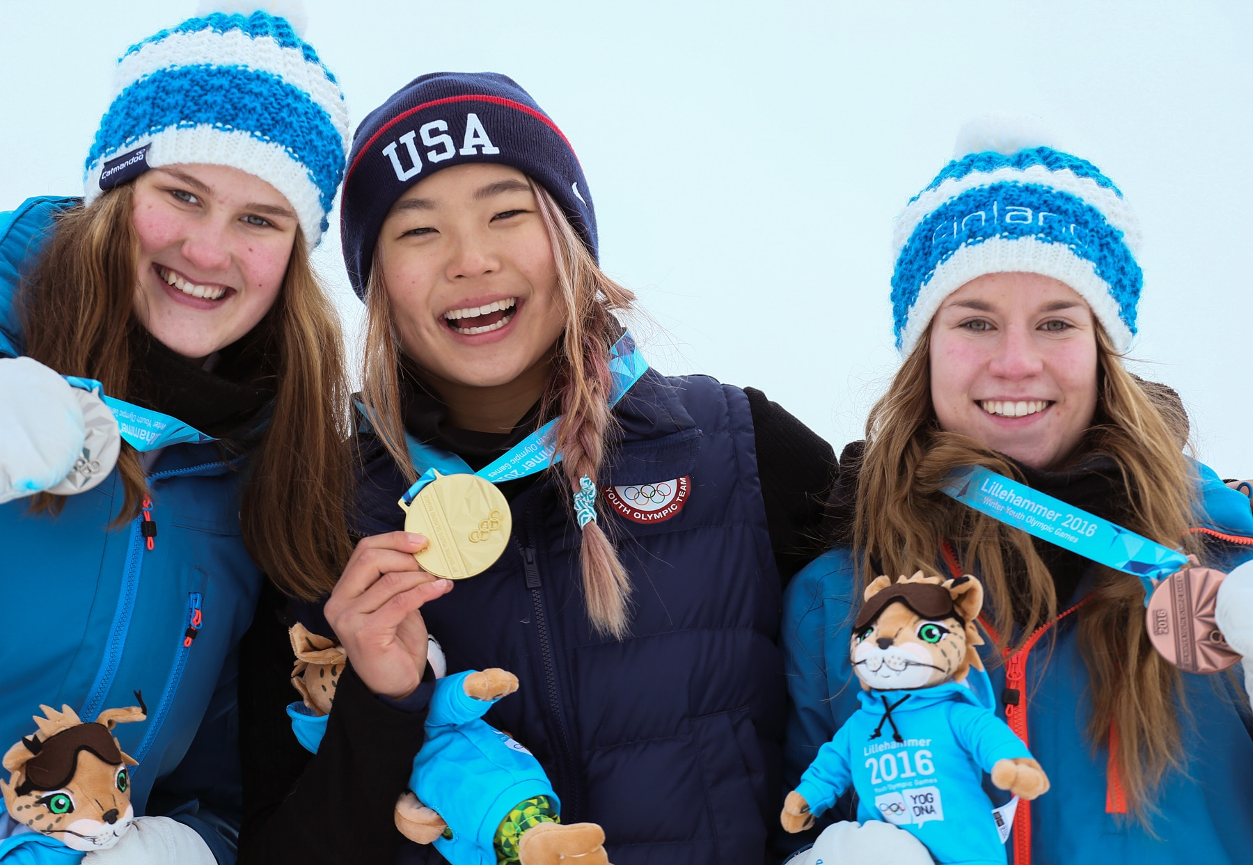 Three women snowboarders showing off medals (Youth Information Service/International Olympic Committee)