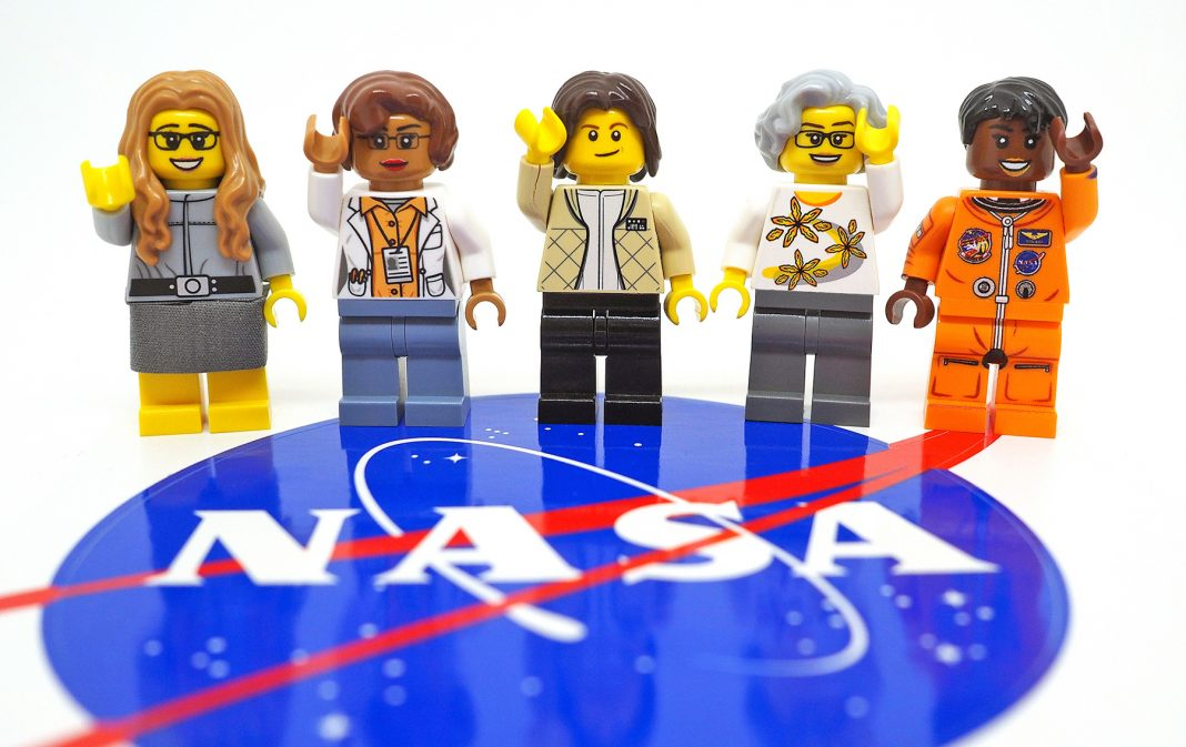 Five Lego figurines with NASA logo in foreground (Maia Weinstock)