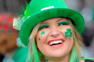 Woman in St. Patrick's Day costume (© AP Images)