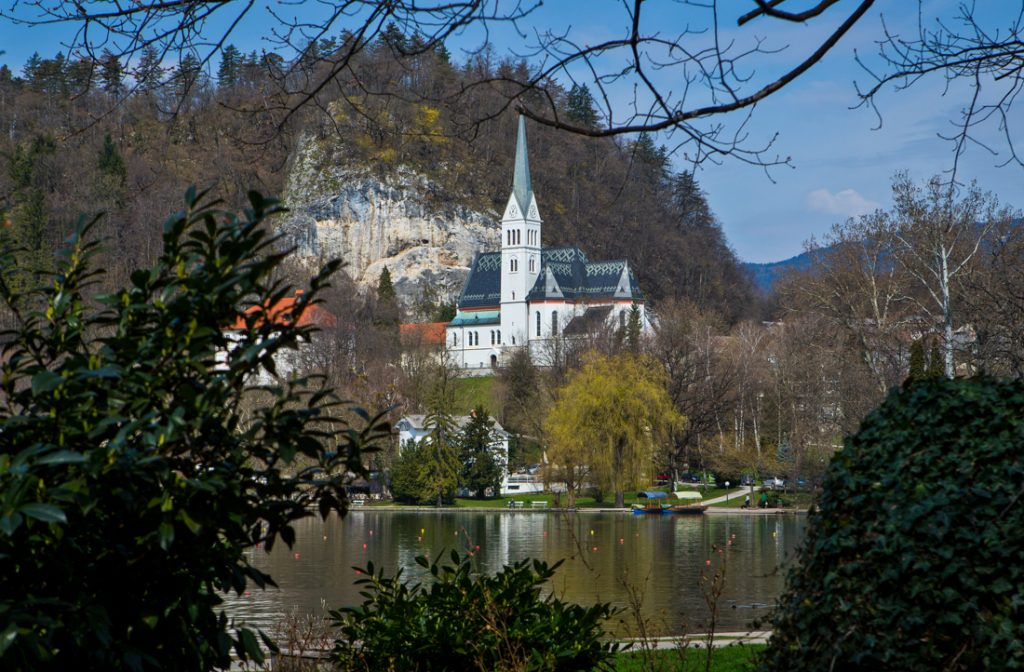 Church sitting on hilltop next to lake (© AP Images)
