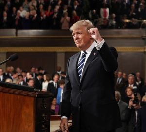 Donald Trump at podium (© AP Images)