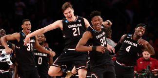 South Carolina basketball players celebrating their win (© AP Images)