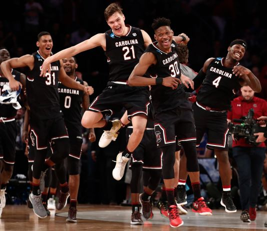 South Carolina basketball players celebrating their win (© AP Images)