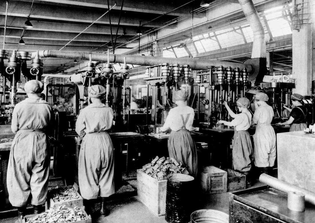 Vintage photo of women working in factory (© AP Images)