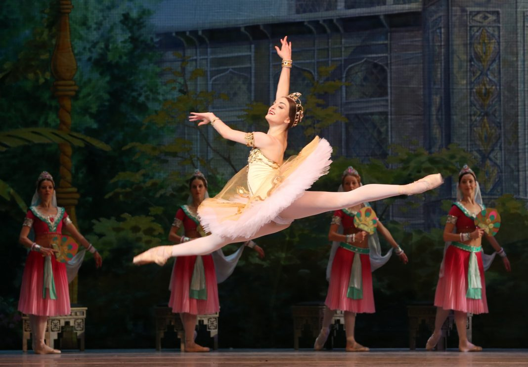 Ballerina leaping in air (© Getty Images)