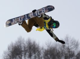 Snowboarder flying in air (© Getty Images)