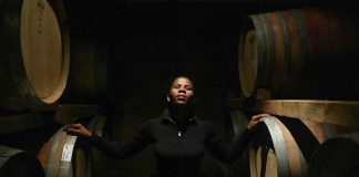 A woman posing between wine barrels (© Gianluigi Guercia/AFP/Getty)