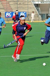 Rabia Qadir playing field hockey