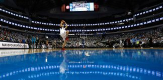 Man shooting basketball on court in arena (State Dept./Ralph Lauer)