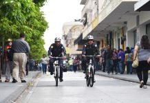 Police officers riding bicycles (U.S. Embassy Guatemala)