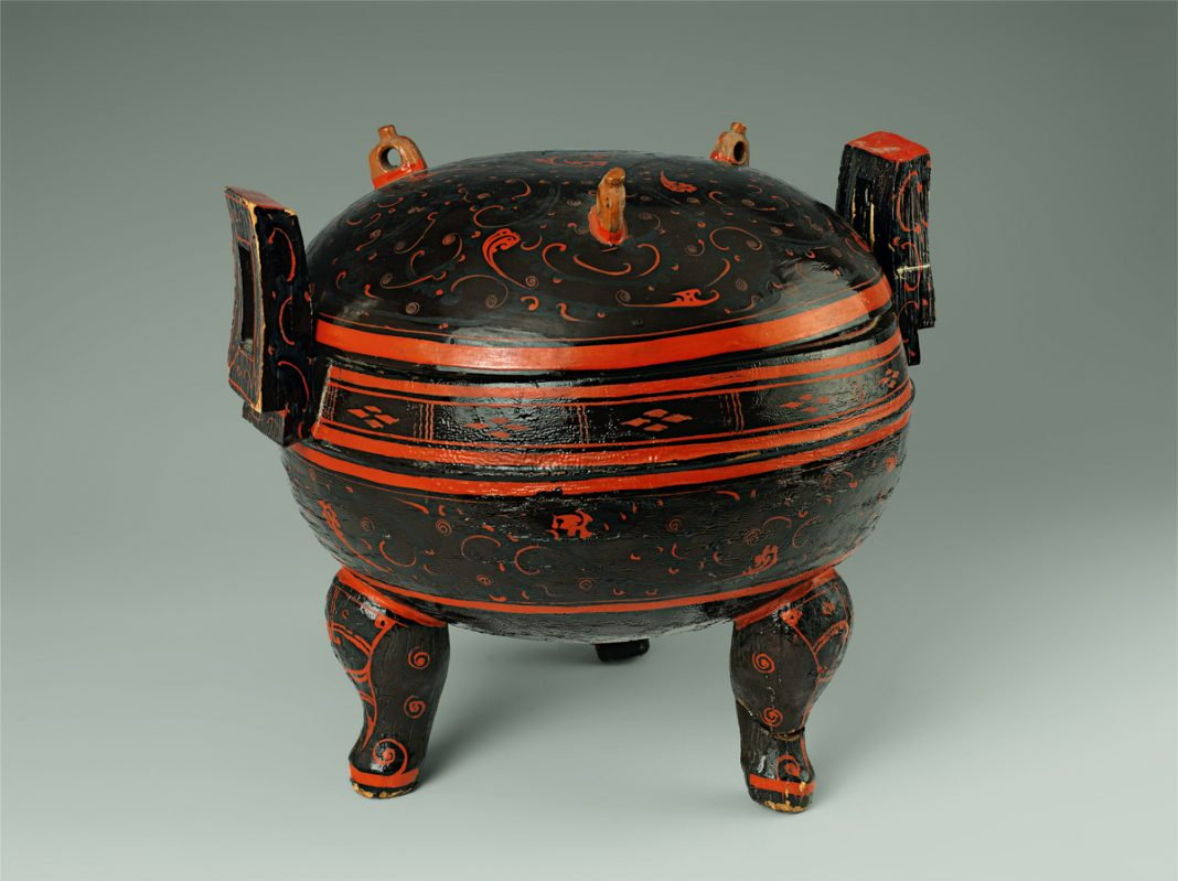 Three-legged wooden pot with handles, decorated with orange and black lacquer (Courtesy of Hunan Provincial Museum, Changsha)