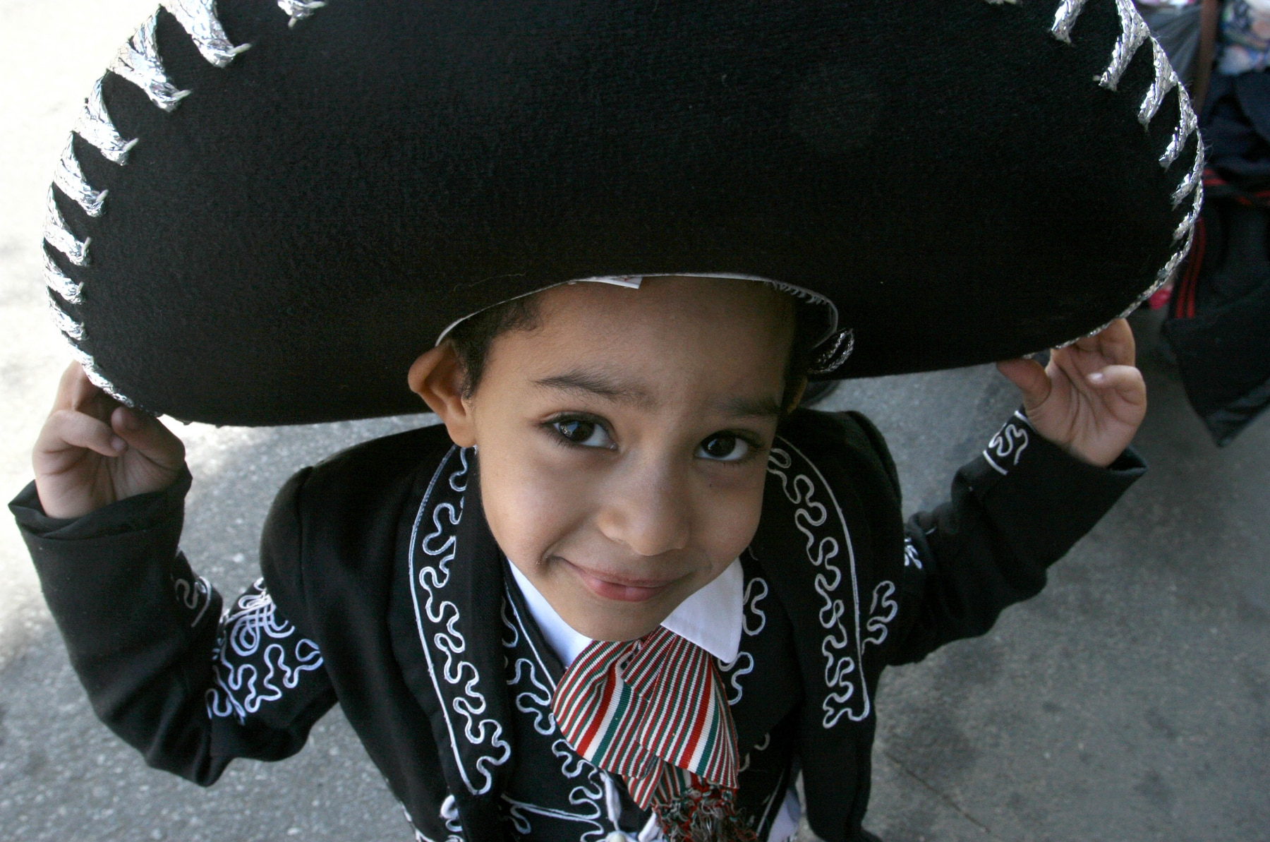 Boy wearing mariachi costume (© AP Images)