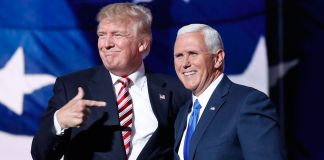 Donald Trump and Mike Pence side by side, with Trump pointing at Pence (© AP Images)