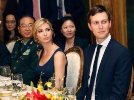 Ivanka Trump and Jared Kushner sitting at dinner table (© AP Images)
