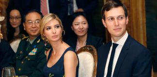 Ivanka Trump and Jared Kushner sitting at dinner table (© AP Images)