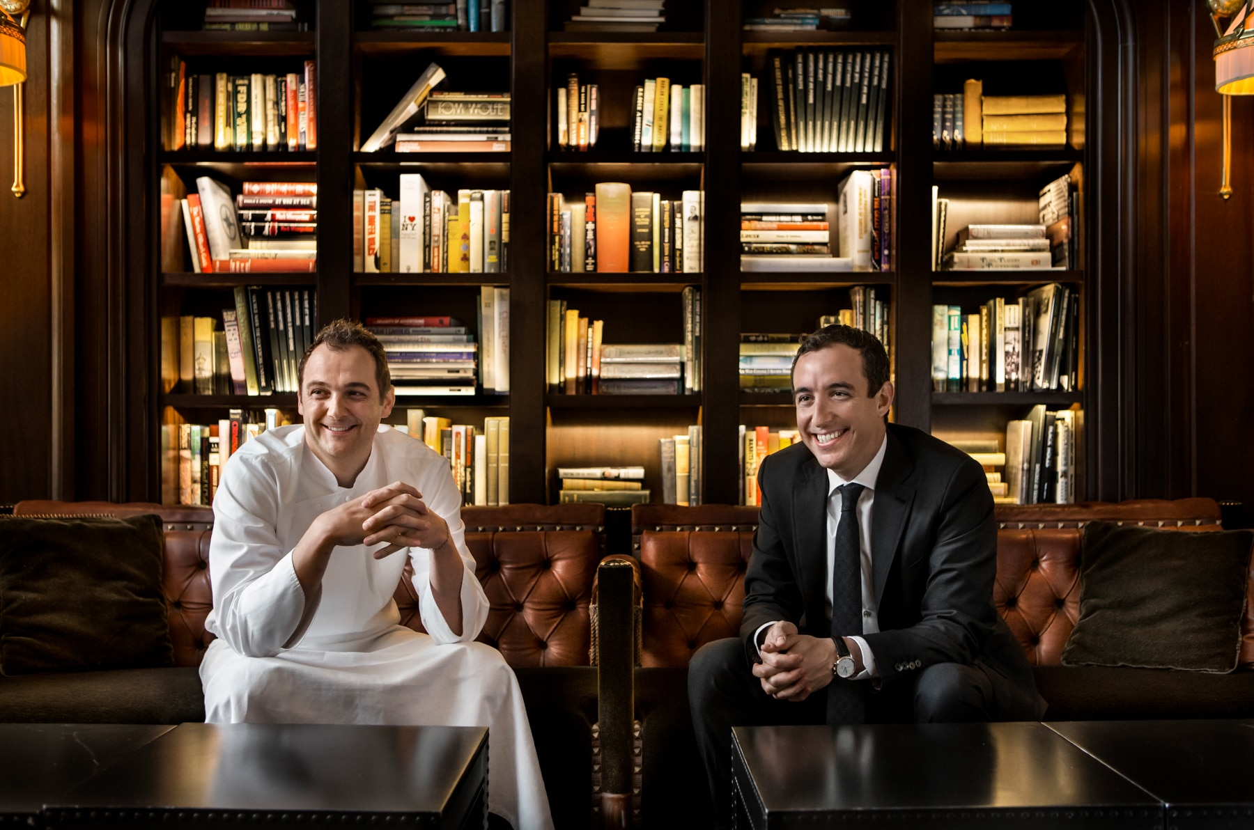 Daniel Humm and Will Guidara seated in front of bookcase (Francesco Tonelli)