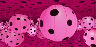 Illuminated pink spheres with black polka dots in room of mirrors (Hirshhorn Museum)