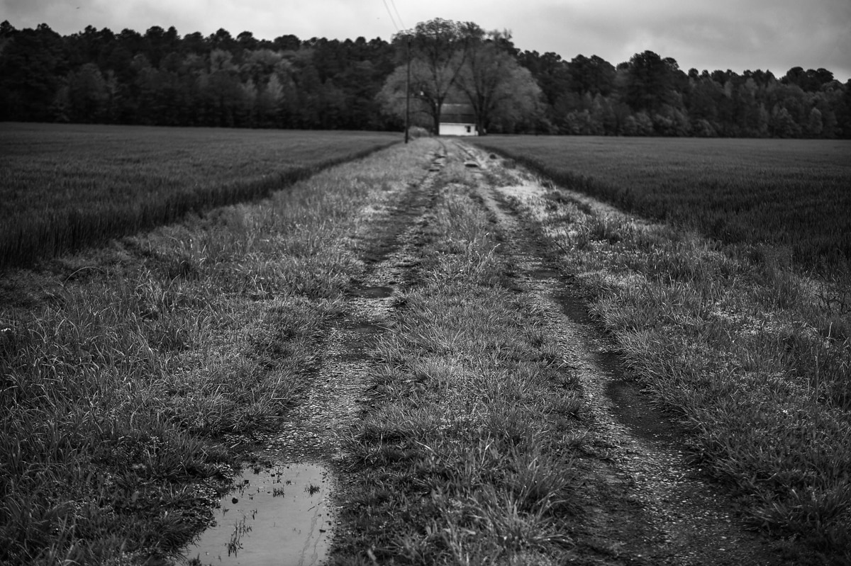 Dirt road leading to small building (State Dept./Astrid Riecken)