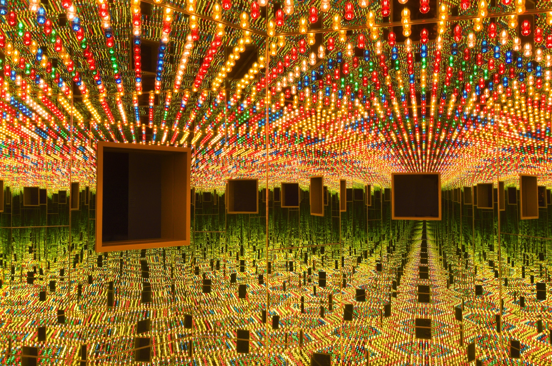 Ceiling filled with colored lightbulbs, in room of mirrors (HIrshhorn Museum)