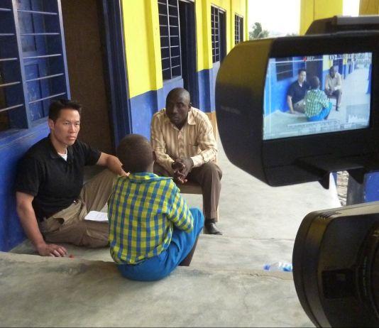 Three men talking (Courtesy of Richard Lui)