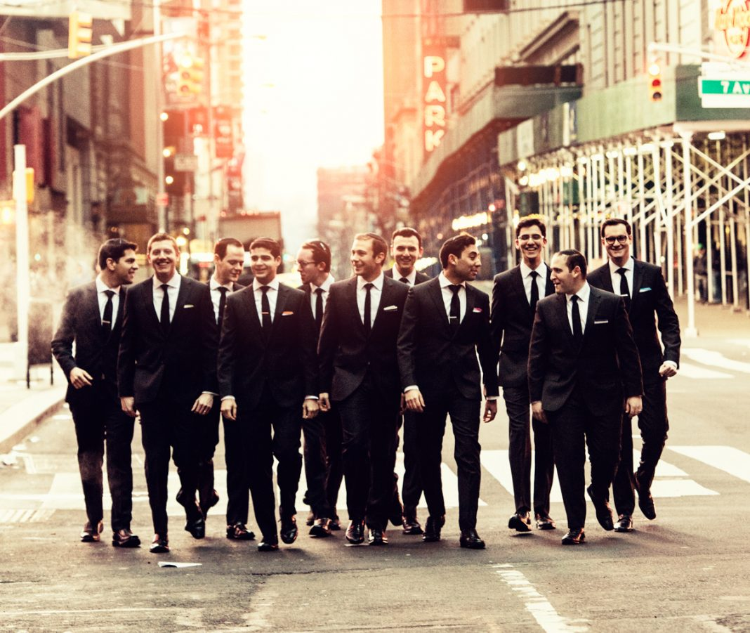 Group of men in suits walking down city street (Dani Diamond)