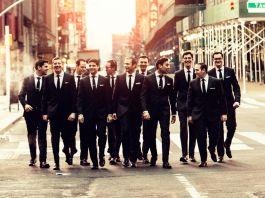 Group of men in suits walking down city street (Dani Diamond)