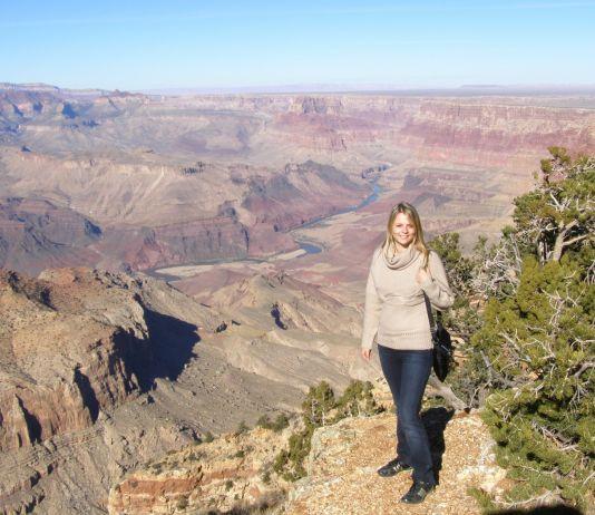 Woman standing at edge of canyon (Courtesy of Mariia Kharina)