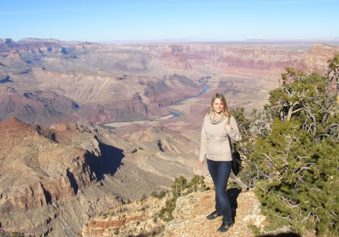 Woman standing at edge of canyon (Courtesy of Mariia Kharina)