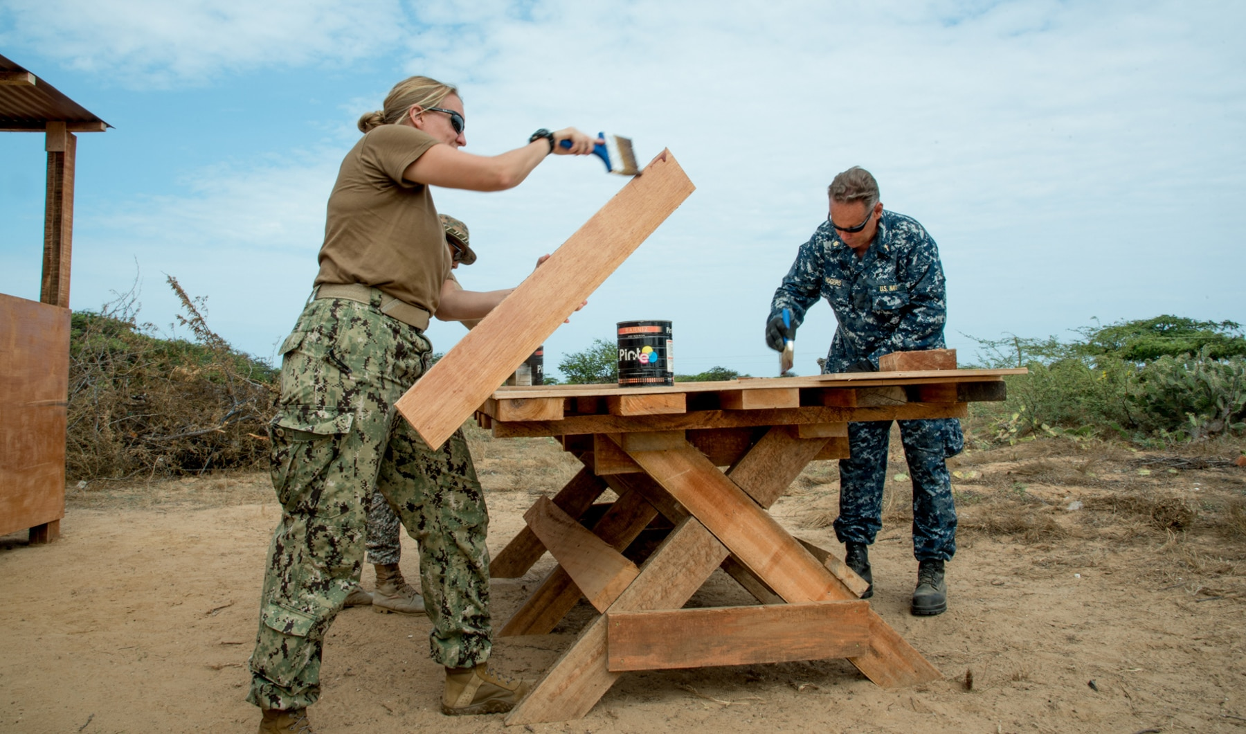 Military members painting new picnic table (U.S. Embassy Bogota)