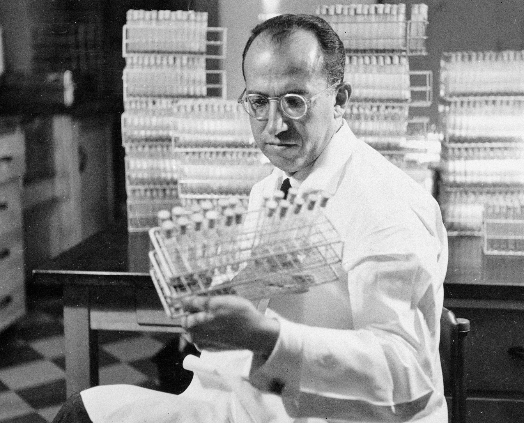 Jonas Salk viewing vials (© AP Images)