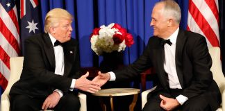 President Trump and Malcom Turnbull seated and shaking hands (© AP Images)