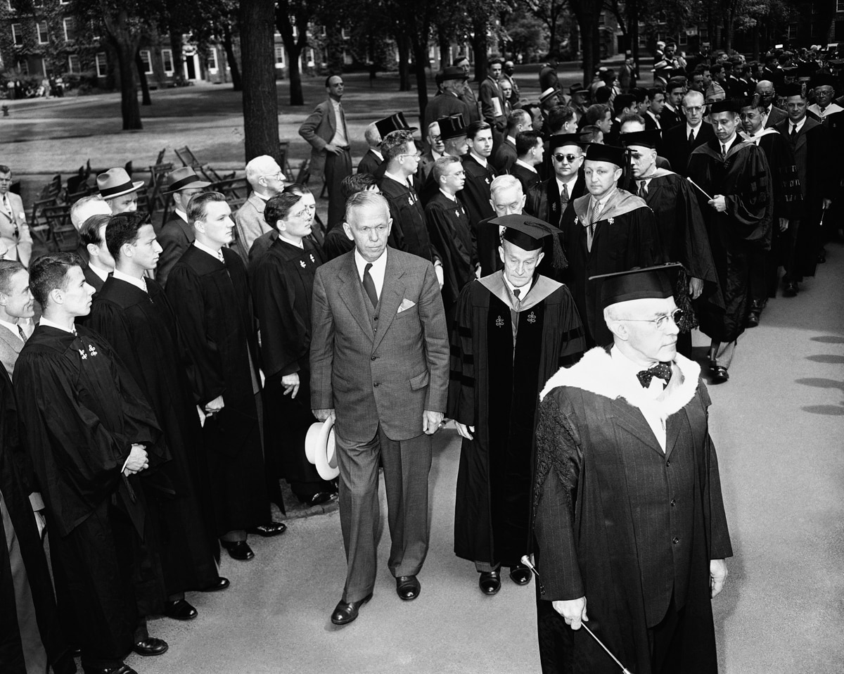 Secretary of State George Marshall joins in a procession before speaking at Harvard University on June 5, 1947.(Associated Press)