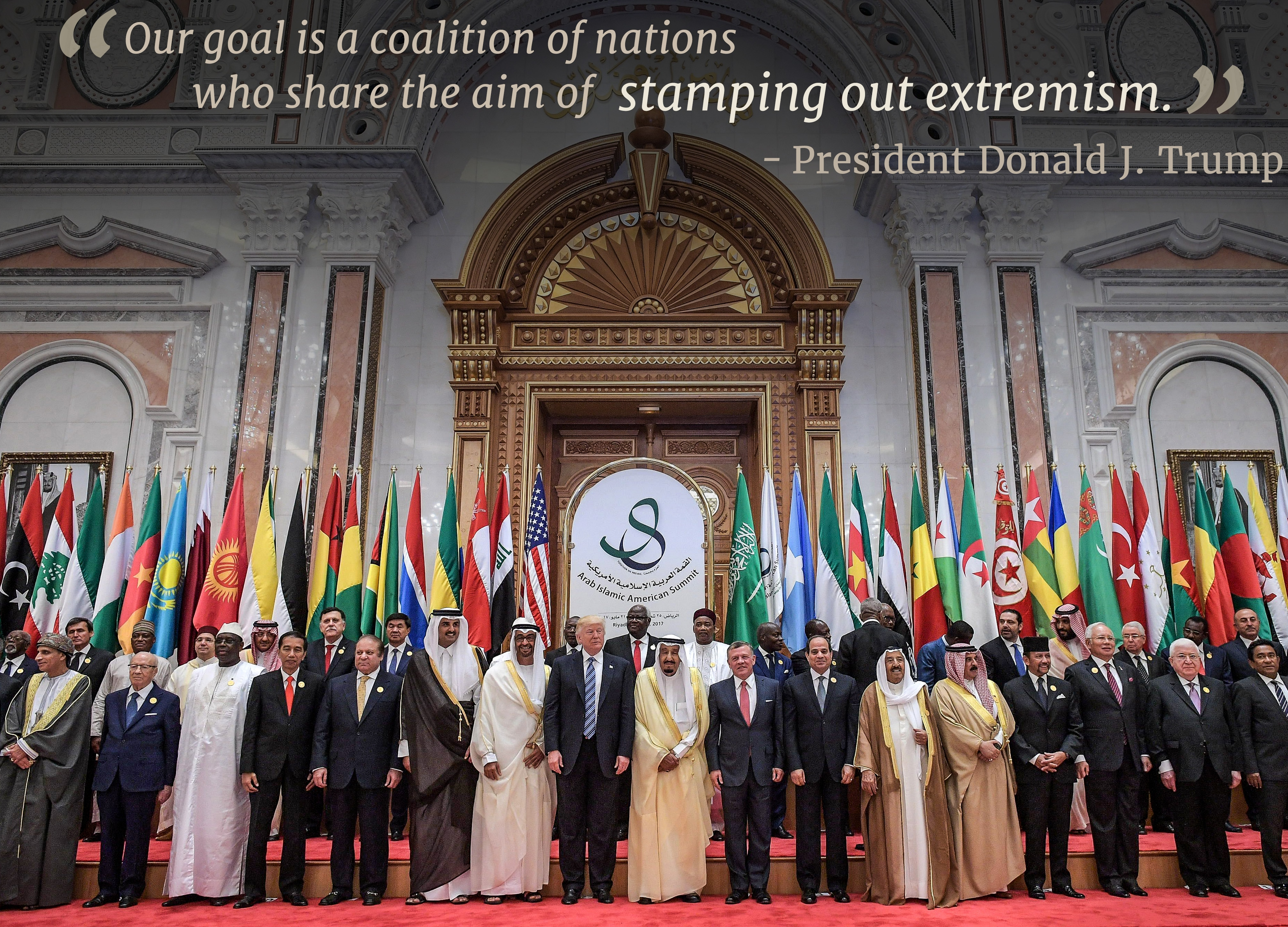 Group of people standing in line in front of flags with overlaid text 'Our goal is a coalition of nations who share the aim of stamping out extremism' (© Mandel Ngan/AFP/Getty)