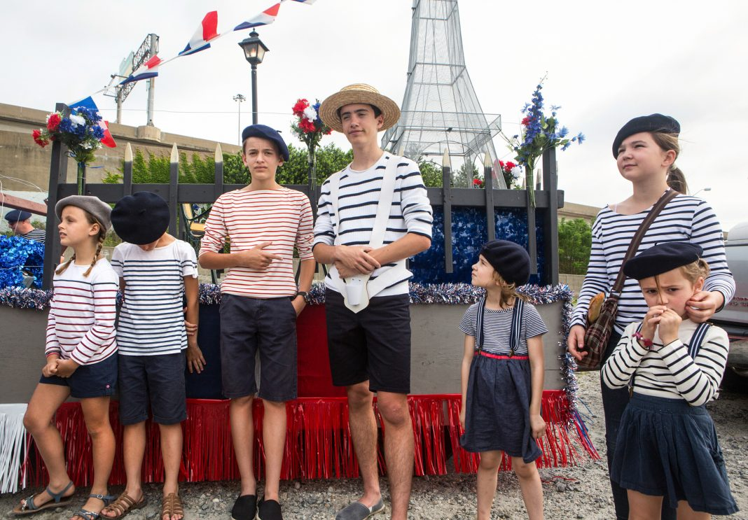 Children on parade float in front of Eiffel Tower replica (State Dept./D.A. Peterson
