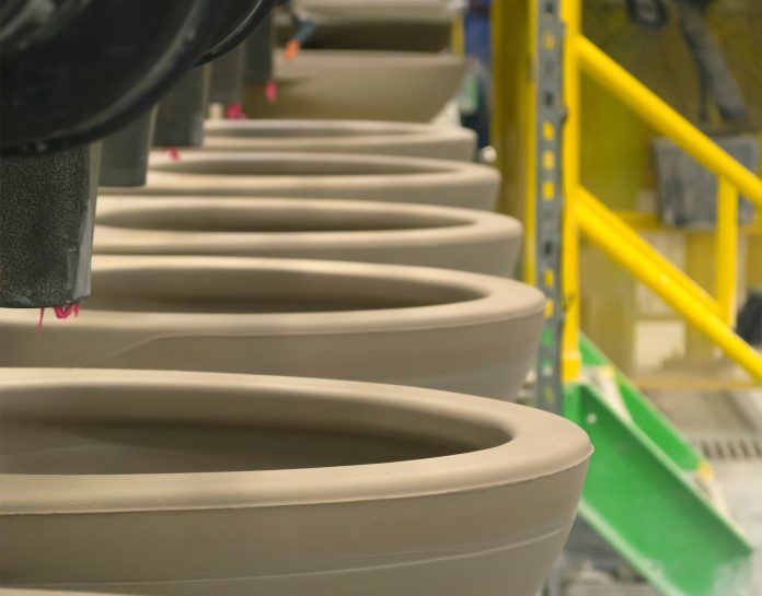 Row of toilets on an assembly line (TOTO USA)