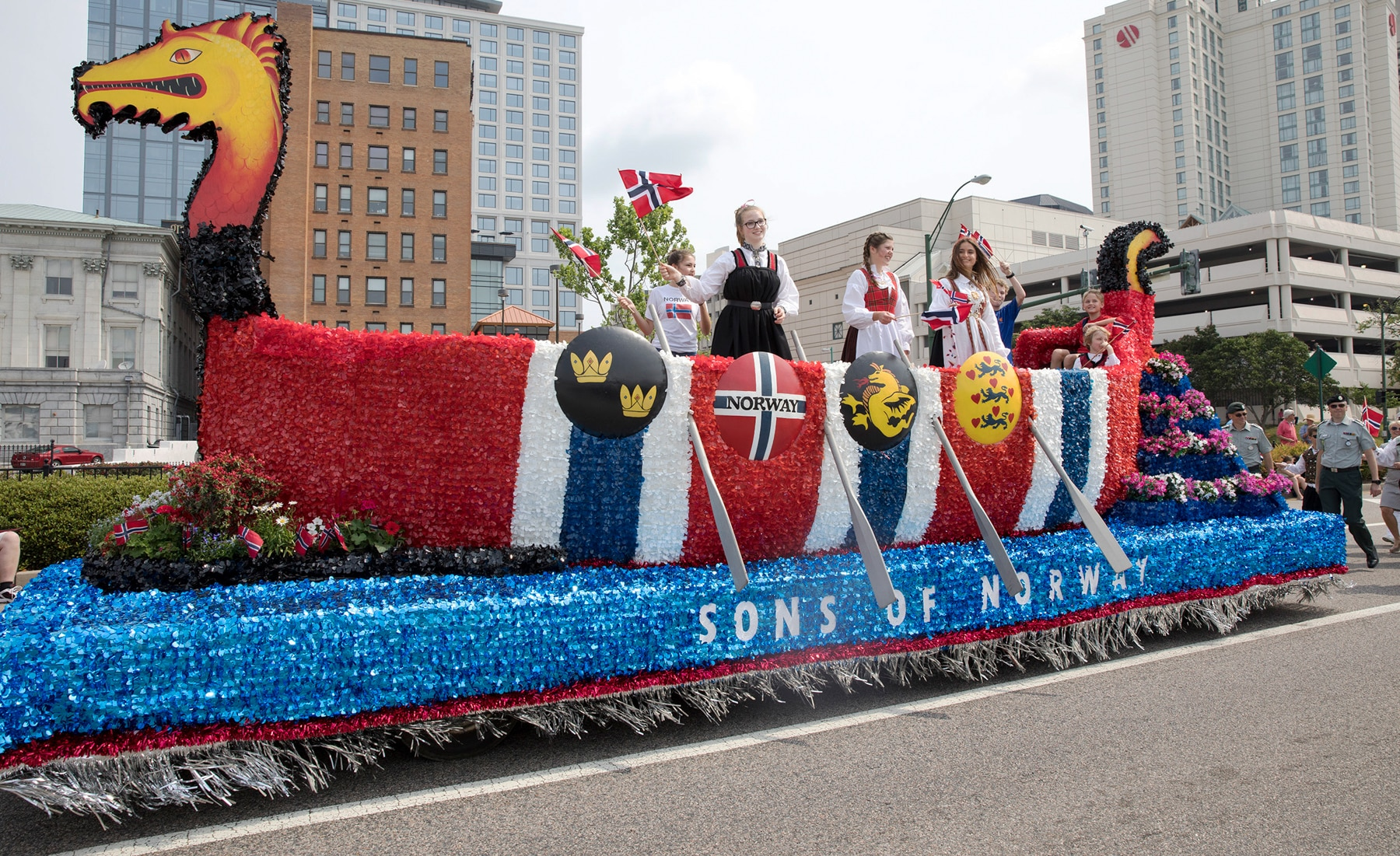 People riding parade float shaped like boat (U.S. Navy/Abraham Essenmacher)