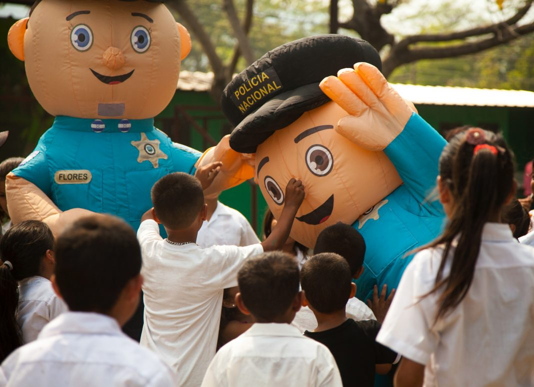 Children reaching for inflated cartoon characters (State Dept./Ariel Flores)