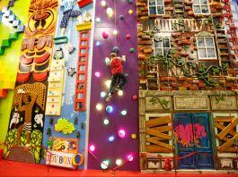 Child climbing a designed wall (ClimbZone)